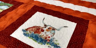 Quilt made from longhorn fabric art print.