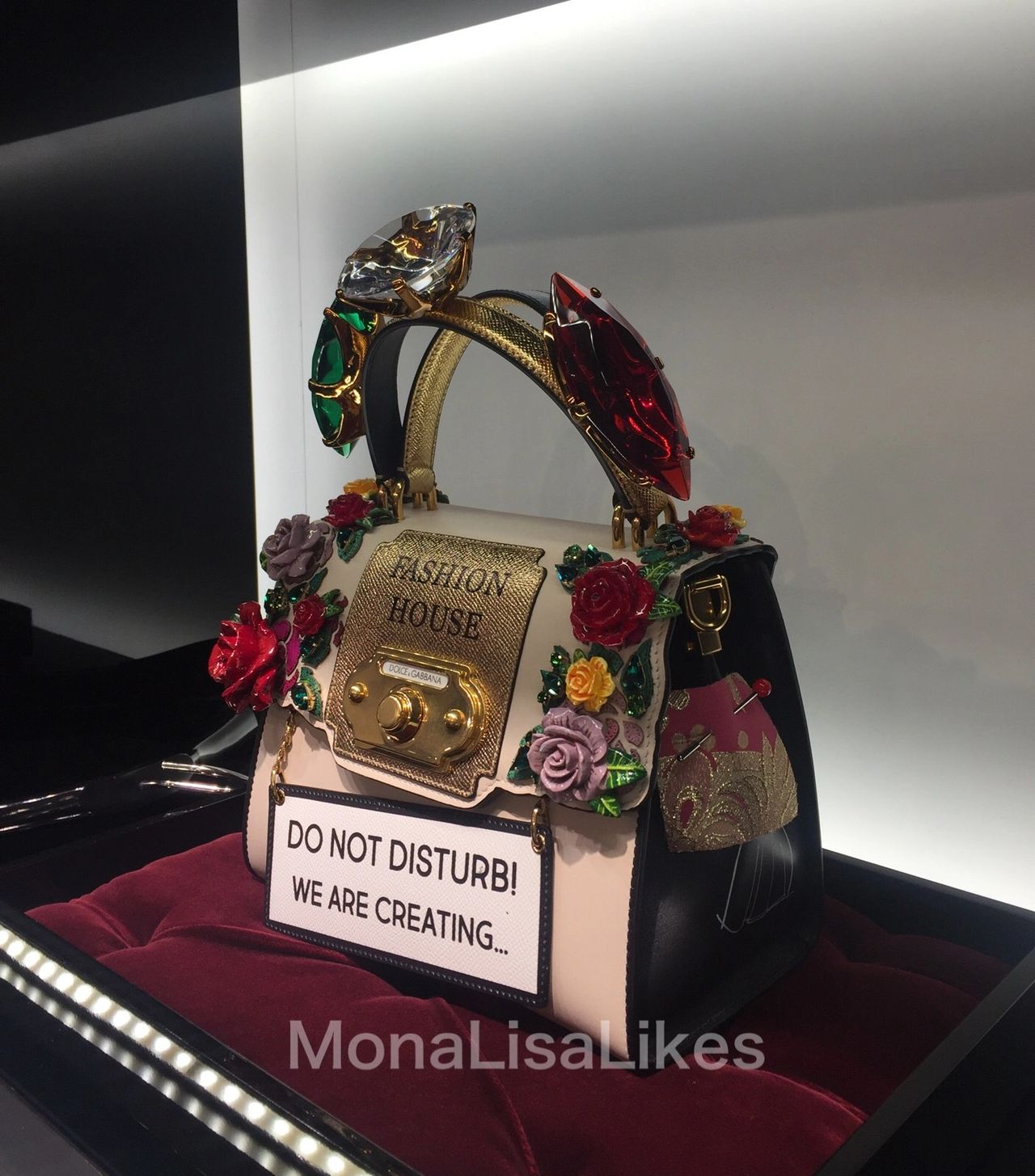 "DOLCE & GABBANA Welcome Bag with ""Do not disturb! We are creating"" sign, embellished with oversized crystals and porcelain roses"