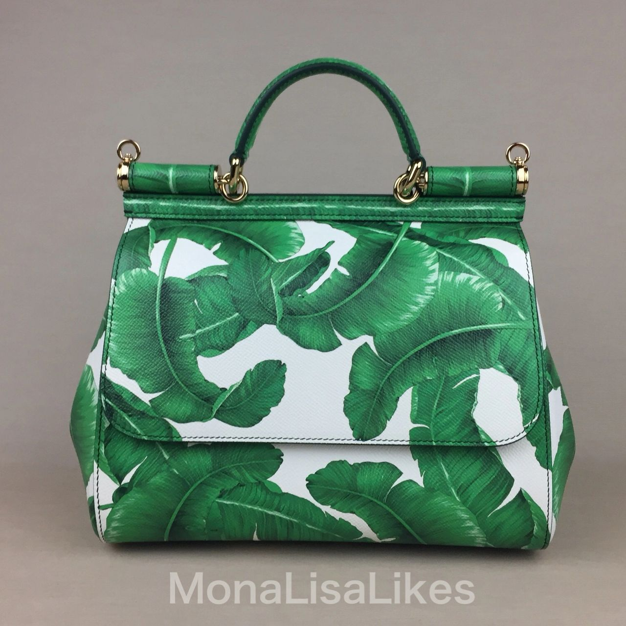 DOLCE & GABBANA Palm Leaves print like one on this Sicily purse created a whole trend, copied by numeroud designers including Michael Kors