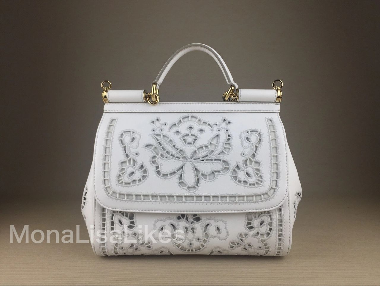 DOLCE & GABBANA Miss Sicily Laser Cut Nappa handbag (called Intaglio in Italian) is a part of regular collections for 3 years in a row, remaining the hottest find