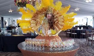 Beautiful show girls greet guests as strolling tables, champagne dress diva, and living statues.