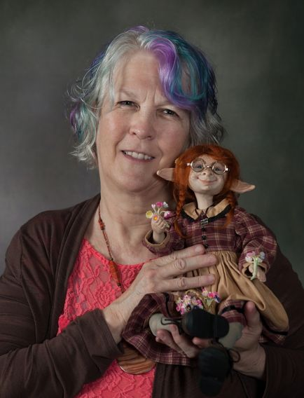 "Artist Debbie Weimert with her artdoll ""Hope"""