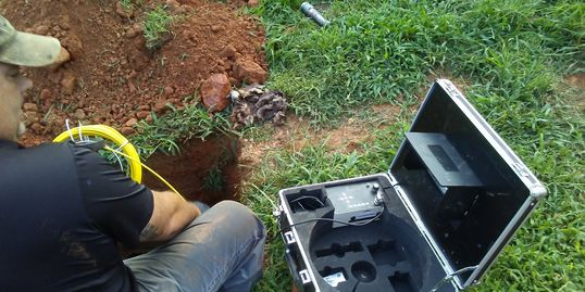 Inspector performing a Septic Inspection.  Photo: Using camera to view the Septic system.