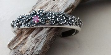 Handcrafted sterling silver flower cuff bracelet from J'tara's jewelry boutique.