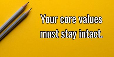 "Two pencils with the text ""your core values must stay intact."""