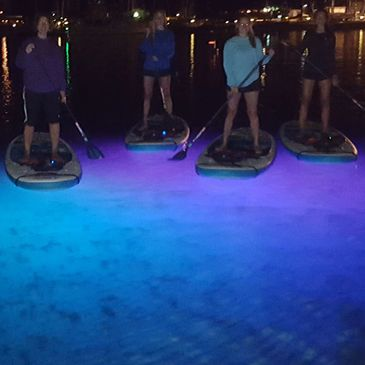 stand up paddle boards with lights in harbor springs. Rent boards with lights or book a tour.