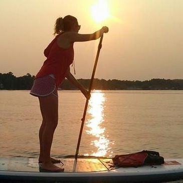 Harbor Springs Paddle Board Club offers  guided stand up paddle board sunset tours of the harbor