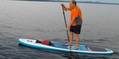 how to stand up paddle board in harbor springs michigan. learn how to paddle board from a pro