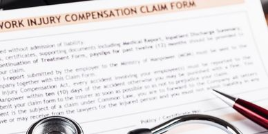 Workers Compensation Claim Form with doctors equipment