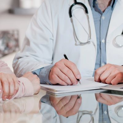 Doctor reviewing patient medical forms