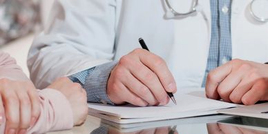 Doctor reviewing forms with patient.