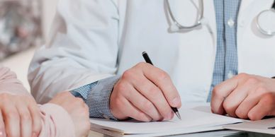 Doctor reviewing medical forms with patient