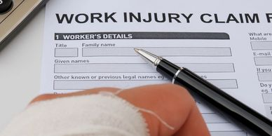Work Injury Claim form and injured hand.