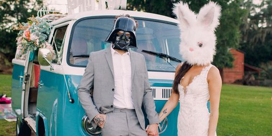 Vada the Gypsy Belle Photo Bus with people posing with Darth Vader and Bunny Mask.