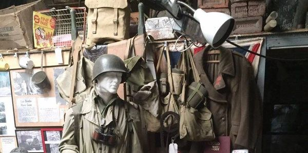 Wartime uniforms, ammo boxes, canvas bags, signs and other ephemera