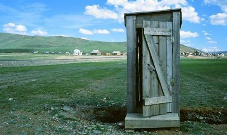 toilet outhouse at the Russia  to Mongolia border in the Altai region