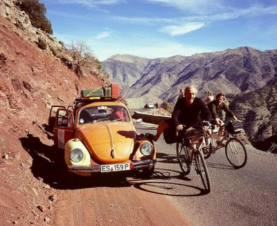 Orange Volkswagen beetle crossing the Atlas Mountains on the plymouth - banjul banger rally