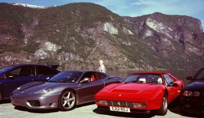 Ferrari 328 and ferrari 575 by a fjord and mountains in Norway