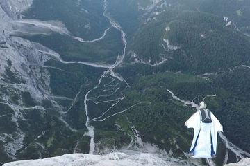 Dropzone owner Tony wingsuit base jumping the Italian mountains.
