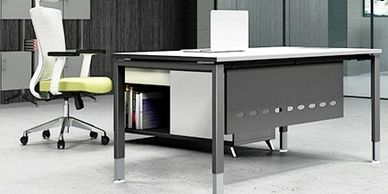 Office furniture manufacturer-office table design with metal legs and large filing cabinet behind