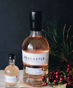 A 50 cl Bottle of Redcastle Blood Orange and Rhubarb Gin Liqueur with a 5cl mini bottle