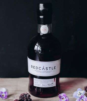 A bottle of Redcastle Raspberry and Pomegranate Gin Liqueur