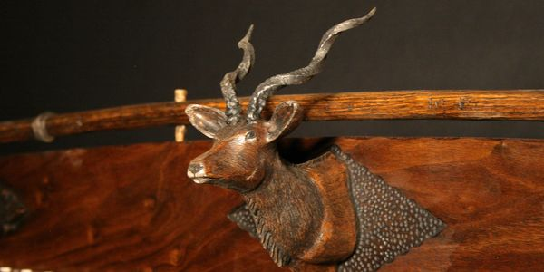 hand carved wildlife, forged antlers, intricate carving detail