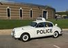 Stuart Exelby's Staffordshire Constabulary Jaguar 240 being driven round the museum by Ant Anstead.