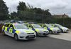 Line up of a mixture of Sussex Police Ford Estates
