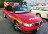 Red so the London Diplomats could spot it.  Metropolitan Police RDPG Vauxhall Omega.