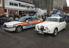 Different decades but same use. Jaguar and Rover side by side.