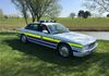 Taking a breather in the shake Adrian Cottle and his Wiltshire Constabulary Driving School Jaguar XJ6.