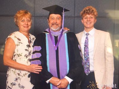 Dr. Mike (center) with his wife, Linda (left) and daughter, Maggie (right)
