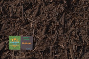 Natural Mulch with Coastal Landscape Supplies business card in the corner.