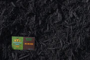 Black mulch with Coastal Landscape Supplies business card in the corner.