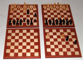 When chess pieces are moved to a preset position, a circuit is closed and can control other devices.