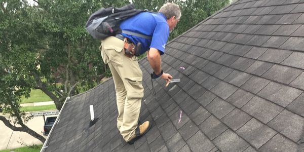 Insurance Adjuster inspecting a Roof