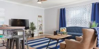Tucson furnished rental near the University of Arizona large common area room with bar and TV.