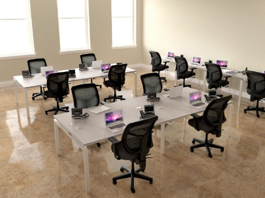 Open Office Area with Laminate Tables and Mesh Back Task Chairs