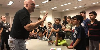 Tween and YA SRC Summer Reading Club program ideas include magic workshop classes taught by professional San Antonio magician Julian Franklin