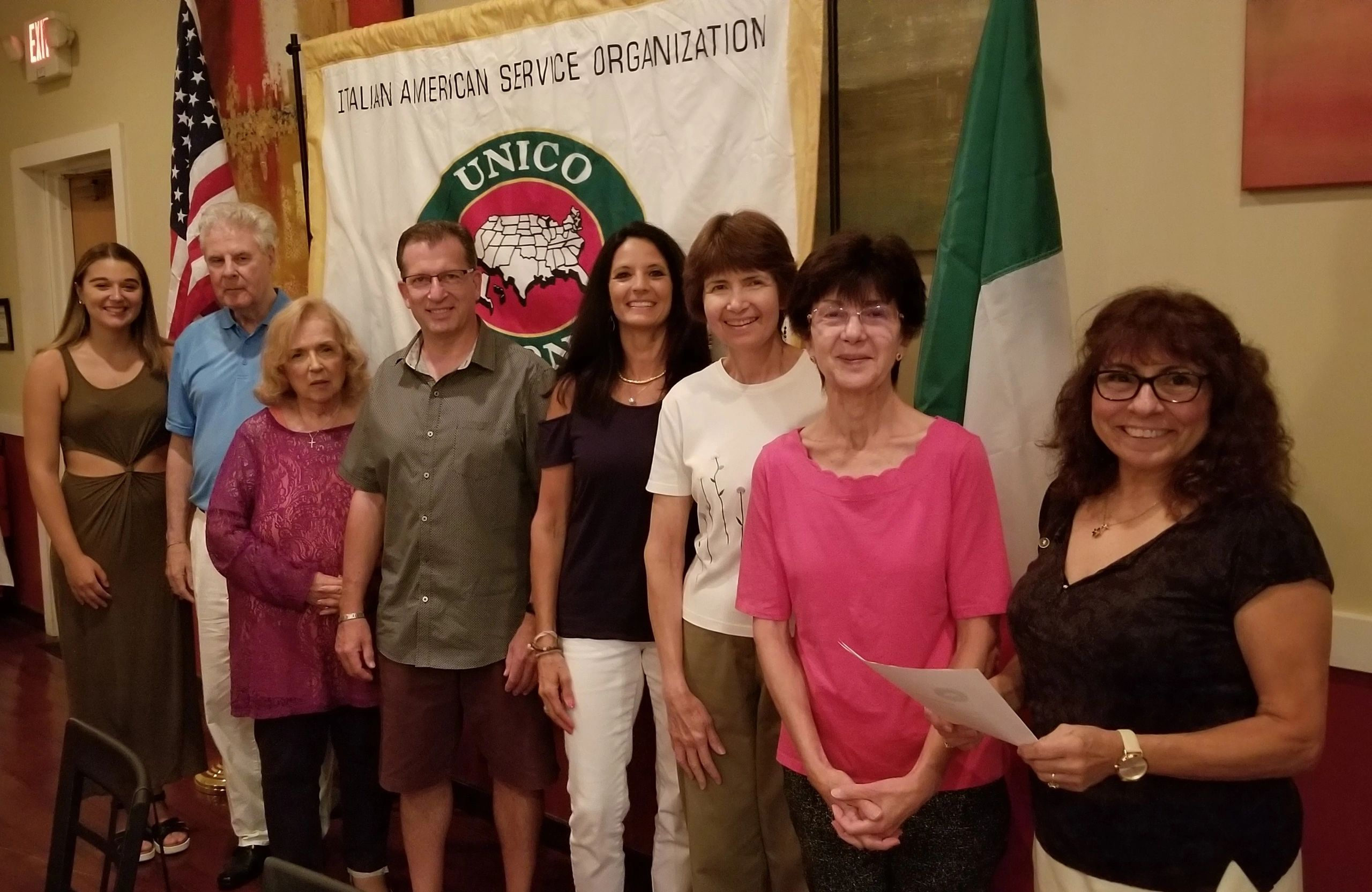 2018-19 Miss UNICO Kirsten Clerico, (far left)  looks on as Vice President Mariann Cialdella (far right) installs new members - L to R: Tom Celllili, Philomena Celllili, Mike Giordano, Sherry Ferrera, Tina Mastrobuono, and Vicki Braun.