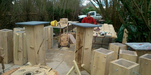 Kevin building Gardeners' Beehives out side work shop area
