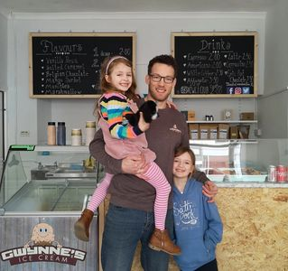 Gwynne's Ice cream is a family run artisan ice cream parlour. images shows father and two daughters