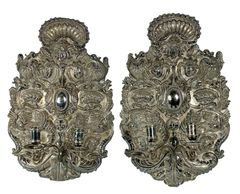 HAND TOOLED SILVER SCONCE FROM PERU