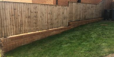 A fence cleaned with the BioGreen system.