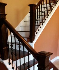 Hardwood flooring, newels, staircase renovation, iron balusters, risers, treads