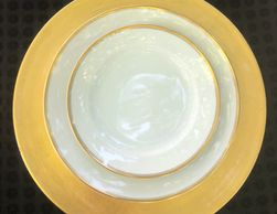 White china plates with gold rim.