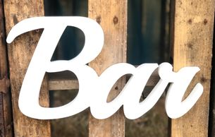 "white script wooden ""bar"" sign"