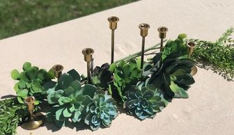 brass candlesticks and faux succulents