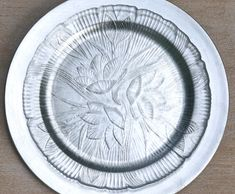 Canterbury clear pressed glass dinner plate on a silver charger.